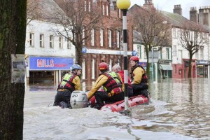 Rescue workers evacuate residents from Cockermouth's main street.