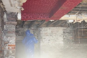 A building contractor ripping out the interior of a shop on Cockermouth's main street, after it was flooded.