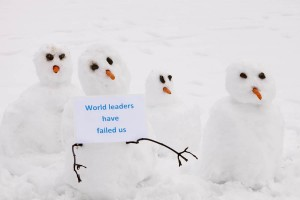 Snowmen protest the failure of world leadersip.