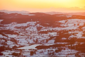 Looking towards Hawkshead from Wansfell at sunset, Lake District, UK.