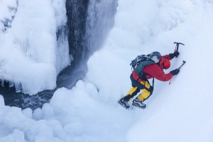 Mike Withers ice climbing on Fisher Place Gill, Thirlmere, Lake District, UK.