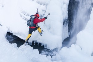 Mike Withers ice climbing in Fisher Place Gill, Thirlmere, Lake District, UK.