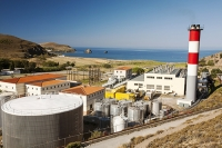 Lemnos;Greece;Limnos;Mirina;Myrina;Aegean;Meditteranean;blue;sun;sunlight;warm;light;blue;building;carbon-footprint;climate-change;global-warming;power-station;electricity;diesel;fossil-fuel;chimney;pollution;emissions;red;smoke-stack;electricity;generation;turbine