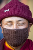 Temple;Kathmandu;Nepal;religion;holy;Buddhism;Buddist;Stoupa;gold;gold-leaf;colour;colourful;prayer-flags;prayer-flag;eye;eyes;Stoupa;dome;shrine;Budda-Stoupa;Boudanath;boudanath-Stoupa;boudha;Boudha-Stupa;stupa;worship;deity;monk;buddist-monk;hat;eyes-closed;face-mask;smog-mask;air-pollution