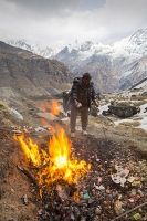 Nepal;Asia;polluted;pollution;rubbish;litter;trash;plastic;garbage;environment;Himalayas;fire;flame;heat;man;male;Annapurna;Annapurna-Base-Camp;snow;peak;mountains