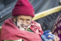 Nepal;Asia;girl-face;clothing;woman;face-mask;pollution;air-quality;Kathmandu;hat;red;old;old-age;OAP;pensioner;lines;lined;face