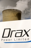 Drax;Drax-power-station;power;power-station;generating;electricity;climate-change;global-warming;emissions;greenhouse-gas;polluter;polluting;electricity;Yorkshire;UK;energy;grid;electric;cooling-tower;infrastructure;sign;biofuel;bio-fuel;wood;greenwash;greenwashing;C02;carbon-dioxide;greenhouse-gas;coal-coal-fired-power-station;conversion;converting