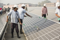 Delhi;India;Asia;investment;investing;growth;Tiger-economy;infrastructure;climate-change;global-warming;energy;power;electricity;Solar;Solar-power;solar-energy;solar-panel;PV;photo-voltaic;generation;generating;green;clean;carbon-footprint;carbon-neutral;1MW;mega-watt;Tata;Tata-Power;renewable;renewable-energy;renewable-power;roof-top;washing;water;water-use;worker;efficiency;dust;dusty