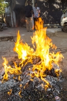 Ahmedbad;India;orange;flame;fire;burning;hot;rubbish;trash;pollution;litter;waste;waste-disposal;discarded;dirty;environment;incinerate;Indian;asian;man;male;warming;heat;hot