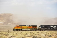 USA;US;America;California;Mojave-Desert;desert;sand;dry;scrub;bush;vegetation;tumble-weed;sky;cloud;dust;dusty;air-pollution;dust-storm;drought;climate-change;global-warming;bridge;railway;railroad;BNSF;orange;locomotive;engine;power;powerful