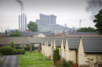 Eston;Middlesborough;Teeside;UK;North-East;town;urban;industry;industrial;contrast;backdrop;pollution;polluted;contamination;poor;poverty;deprived;deprivation;working-class;run-down;community;pylon;electricity;energy;electricity-generation;sub-station;power-station;health;unhealthy;contaminated;contamination;environment;car;shop;community;steel-works;industrial-complex;chemical-plant;house;housing