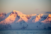 Austral;South-Atlantic;Antarctic;Antarctic-Peninsular;southern-Ocean;Southern;climate-change;global-warming;sunlight;Antarctica;rock;rocky;cliff;sea-cliff;iceberg;landscape;ice;sea-ice;ice-sheet;glacier;glacial-retreat;white;mountain;ridge;rugged;remote;vista;view-point;view;stunning;awesome;landscape;sheltered;weather;cloud;sky;calm;bay;Graham-Land;pristine;wilderness;reflection;bergy-bits;brash-ice;sea-ice-retreat;glacier;snow;mountain-range;Gerlache-Strait;Palmer-Archipelago;Anvers-Island;awe-inspiring;inspiring;inspirational;remote;light;glow;colour;sunset;evening