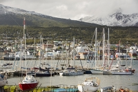 Ushuaia;Tierra-del-Fuego;Argentina;Patagonia;South-America;Austral;town;South;southerly;red;tourism;Isla-Grande-de-Tierra-del-Fuego;Beagle-Channel;Martial-Mountain-Range;travel;mountain;hill;peak;snow;snow-capped;glacier;sky;rock;rugged;mountain-range;ship;boat;docks;dock;wharf;port;yacht;sailing-boat;mast;sailing;mooring
