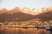 Ushuaia;Tierra-del-Fuego;Argentina;Patagonia;South-America;Austral;town;South;southerly;red;tourism;Isla-Grande-de-Tierra-del-Fuego;Beagle-Channel;Martial-Mountain-Range;travel;mountain;hill;peak;snow;snow-capped;glacier;sky;rock;rugged;mountain-range;ship;boat;docks;dock;wharf;port;boat;mooring;rocky;rock;ridge;rugged;snow;snow-capped;sunrise;red;glow;light;warm;harbour;dawn;harbour