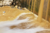 orange;brown;river;water;water-supply;polluted;pollution;contaminated;mine-waste;effluent;La-Paz;Bolivia;South-America;sediment-load;colour;discoloured;iron;water-shortage;waterfall;scum