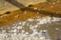 orange;brown;river;water;water-supply;polluted;pollution;contaminated;mine-waste;effluent;La-Paz;Bolivia;South-America;sediment-load;colour;discoloured;iron;water-shortage;waterfall;water-shortage;scum;sewage;sewerage;raw-sewage;mixing;environment;dirty;smelly;foul