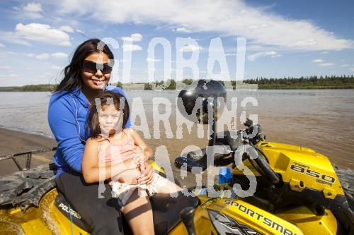 Candice Orr Bouchier and daughter from the First Nation community of Fort KcKay, downstream of the tar sands industry on the banks of the Athabasca river. Many residents of Fort McKay are suffering health problems, but the government refuses to investigate a link to the tar sands industry.