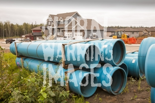 Pipeline construction work in Fort McMurray in the heart of the Canadian tar sands. The tar sands is the world's largest industrial project and the most environmentally destructive. The pipelines carry the raw bitumen refined from the tar sands. Most of the pipelines are operated by Enron. They have an unenviable reputation when it comes to safety. Their pipelines leak on average at least once a week. There are several proposed new pipeline routes to get the oil to market in the USA, but protests meet Enron, wherever they propose to lay a new pipeline.