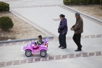 China;person;human;chinese;race;ethnicity;ethnic;child;toy;toy-car;car;remote-control;family;parents;progress;wealth