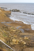defences;sea;sea-defences;global-warming;sea-level-rise;erosion;coastal-erosion;glacial;till;deposits;beach;cliff;collapse;coast;Happisburgh;Norfolk;sea-defences;rapid-erosion;threat;vulnerable;edge;sea-level-rise;crumbling;soft;concrete;remains;house;destroyed