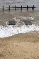 defences;sea;sea-defences;global-warming;sea-level-rise;erosion;coastal-erosion;glacial;till;deposits;beach;cliff;collapse;coast;Happisburgh;Norfolk;sea-defences;rapid-erosion;threat;vulnerable;edge;sea-level-rise;crumbling;soft;concrete;remains;house;destroyed;concrete