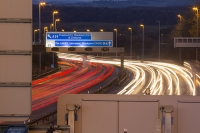 motorway;car;vehicle;climate-change;global-warming;M6;travel;transport;lane;markings;white-line;headlights;slow-shutter;motion-blur;movement;speed;speeding;dusk;evening;dark;rush-hour;congestion;congested;road-sign;Preston;blackpool;clitheroe;Lancaster;blackpool;M55;directions