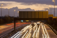 motorway;car;vehicle;climate-change;global-warming;M6;travel;transport;lane;markings;white-line;headlights;slow-shutter;motion-blur;movement;speed;speeding;dusk;evening;dark;rush-hour;congestion;congested;lorry;truck;haulage;road-sign