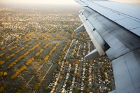 plane;airplane;wing;flight;aviation;American;USA;New-York;New-York-City;aerial;real-estate;built-up;urban;tree;Fall;Autumn;suburbs;suburban;house;housing;detatched;cemetery;burial;grave-yard;death;scale;grave-stone