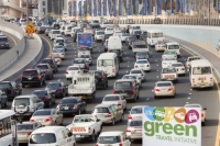 Dubai;Middle-East;arabic;road;highway;car;car-culture;lane;gas-guzzlers;climate-change;global-warming;pollution;travel;transport;exhaust;carbon-footprint;C02;emmissions;rush-hour;busy;sign;banner;green;green-travel;green-transport;protest;placard;contrast