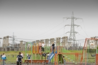 Eston;Middlesborough;Teeside;UK;North-East;town;urban;industry;industrial;contrast;backdrop;children;play;playing;playground;swing;slide;pollution;polluted;contamination;poor;poverty;deprived;deprivation;working-class;run-down;community;pylon;electricity;energy;electricity-generation;sub-station;power-station;health;unhealthy;contaminated;environment
