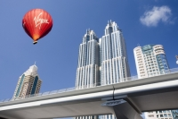 Dubai;Middle-East;arabic;high-rise;tower-block;development;luxury;wealthy;expensive;architecture;design;construction;building;building-site;Emirates;tower;glass;glass-fronted;reflection;hot-air-balloon;balloon;basket;red;Virgin;brand;logo;flying;flight;airbourne;aloft;wind;drift;drifting