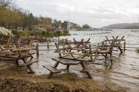 Floods;flooding;flooded;Ambleside;Cumbria;Lake-District;UK;weather;extreme-weather;climate-change;global-warming;deluge;torrential-rain;downpour;meteorology;low-pressure;weather-front;rain;raining;heavy-rain;precipitation;wet;sodden;Wateredge;Inn;pub;hotel;surrounded;marooned;insuramnce;insurance-claim;flood-debris;beer-garden;table;picnic-table
