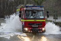 Floods;flooding;flooded;Ambleside;Cumbria;Lake-District;UK;weather;extreme-weather;climate-change;global-warming;deluge;torrential-rain;downpour;meteorology;low-pressure;weather-front;rain;raining;heavy-rain;precipitation;wet;sodden;emergency-services;fire-engine;fire-service;blue-lights;rescue;vehicle;flood-waters;River-Rothay;river;flood-water