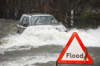 Floods;flooding;flooded;Ambleside;Cumbria;Lake-District;UK;weather;extreme-weather;climate-change;global-warming;deluge;torrential-rain;downpour;meteorology;low-pressure;weather-front;rain;raining;heavy-rain;precipitation;wet;sodden;land-rover;freelander;vehicle;car;dangerous;flood-waters;river;swamped;stupid;driving-conditions;sign;road-sign;warning;triangle;composite