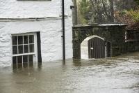 Floods;flooding;flooded;Ambleside;Cumbria;Lake-District;UK;weather;extreme-weather;climate-change;global-warming;deluge;torrential-rain;downpour;meteorology;low-pressure;weather-front;rain;raining;heavy-rain;precipitation;wet;sodden;gate;house;flooded-house;insurance;insurance-claim;flood-damage