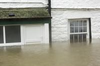 Floods;flooding;flooded;Ambleside;Cumbria;Lake-District;UK;weather;extreme-weather;climate-change;global-warming;deluge;torrential-rain;downpour;meteorology;low-pressure;weather-front;rain;raining;heavy-rain;precipitation;wet;sodden;house;flooded-house;insurance;insurance-claim;flood-damage;door