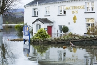 Floods;flooding;flooded;Ambleside;Cumbria;Lake-District;UK;weather;extreme-weather;climate-change;global-warming;deluge;torrential-rain;downpour;meteorology;low-pressure;weather-front;rain;raining;heavy-rain;precipitation;wet;sodden;Wateredge;Inn;pub;hotel;surrounded;marooned;insuramnce;insurance-claim