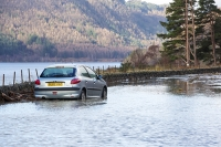 Floods;flooding;flooded;Cumbria;Lake-District;UK;weather;extreme-weather;climate-change;global-warming;deluge;torrential-rain;downpour;meteorology;low-pressure;weather-front;rain;raining;heavy-rain;precipitation;flood-waters;river;Dunmail-Raise;A591;road;swept-away;undermined;flood-damage;road-closed;power;car;abandoned;landslide;land-slip;flood-debris;rock