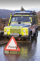 Floods;flooding;flooded;Cumbria;Lake-District;UK;weather;extreme-weather;climate-change;global-warming;deluge;torrential-rain;downpour;meteorology;low-pressure;weather-front;rain;raining;heavy-rain;precipitation;flood-waters;river;Dunmail-Raise;A591;road;swept-away;undermined;flood-damage;road-closed;power;car;abandoned;trapped;road;sign;flood;landrover;mountain-rescue;vehicle;abandoned;emergency;emergency-services