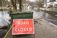 Floods;flooding;flooded;Ambleside;Cumbria;Lake-District;UK;weather;extreme-weather;climate-change;global-warming;deluge;torrential-rain;downpour;meteorology;low-pressure;weather-front;rain;raining;heavy-rain;precipitation;wet;sodden;surrounded;marooned;insuramnce;insurance-claim;pier;Ambleside-Pier;jetty;road-closed;red;road-sign