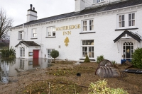 Floods;flooding;flooded;Ambleside;Cumbria;Lake-District;UK;weather;extreme-weather;climate-change;global-warming;deluge;torrential-rain;downpour;meteorology;low-pressure;weather-front;rain;raining;heavy-rain;precipitation;wet;sodden;Wateredge;Inn;pub;hotel;surrounded;marooned;insuramnce;insurance-claim;beer-barrel