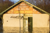 Floods;flooding;flooded;Ambleside;Cumbria;Lake-District;UK;weather;extreme-weather;climate-change;global-warming;deluge;torrential-rain;downpour;meteorology;low-pressure;weather-front;rain;raining;heavy-rain;precipitation;wet;sodden;Wateredge;surrounded;marooned;insuramnce;insurance-claim;Lakeside;picnic;cafe