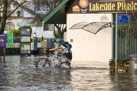 Floods;flooding;flooded;Ambleside;Cumbria;Lake-District;UK;weather;extreme-weather;climate-change;global-warming;deluge;torrential-rain;downpour;meteorology;low-pressure;weather-front;rain;raining;heavy-rain;precipitation;wet;sodden;Wateredge;surrounded;marooned;insuramnce;insurance-claim;Lakeside;picnic;cafe;cyclist;bike;bicycle;boy