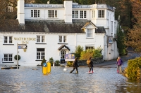 Floods;flooding;flooded;Ambleside;Cumbria;Lake-District;UK;weather;extreme-weather;climate-change;global-warming;deluge;torrential-rain;downpour;meteorology;low-pressure;weather-front;rain;raining;heavy-rain;precipitation;wet;sodden;Wateredge;Inn;pub;hotel;surrounded;marooned;insuramnce;insurance-claim;children;child;girl;wade;wading;Swan;Mute-Swan;storm-Desmond