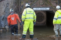 Floods;flooding;flooded;Cumbria;Carlisle;UK;weather;extreme-weather;climate-change;global-warming;deluge;heavy-rain;wet;sodden;road;pipe;piping;pump;pumping;flood-water;flood-waters;draining;aftermath;cleanup;clear-up;Storm-Desmond;Environment-Agency;cost;insurance;insurance-claim;Sands-Centre;tunnel;underpass;colourful;art;street-art;mural;castle;Carlisle-Castle;pedestrian;Hardwicke-Circus;staff;high-vis;health-and-safety;inspection;inspect