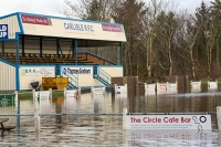 Floods;flooding;flooded;Cumbria;Carlisle;UK;weather;extreme-weather;climate-change;global-warming;deluge;heavy-rain;wet;sodden;flood-water;flood-waters;draining;aftermath;Storm-Desmond;Environment-Agency;cost;insurance;insurance-claim;flood-damage;Warwick-Road;sports;Rugby-Pitch;Rugby-Club;stand;flooded-pitch;low-lying