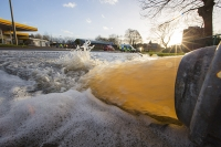 Floods;flooding;flooded;Cumbria;Carlisle;UK;weather;extreme-weather;climate-change;global-warming;deluge;heavy-rain;wet;sodden;road;pipe;piping;pump;pumping;flood-water;flood-waters;draining;aftermath;cleanup;clear-up;Storm-Desmond;Environment-Agency;cost;insurance;insurance-claim;police-car;road-closed