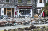 Floods;flooding;flooded;Glenridding;Ullswater;Cumbria;Lake-District;UK;weather;extreme-weather;climate-change;global-warming;deluge;torrential-rain;downpour;meteorology;low-pressure;weather-front;rain;raining;heavy-rain;precipitation;wet;sodden;flood-waters;tarmac;flood-damage;ripped-up;debris;flood-debris;shop;village;fridge;storm-Desmond;village-store;store;mini-market