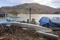 Floods;flooding;flooded;Glenridding;Ullswater;Cumbria;Lake-District;UK;weather;extreme-weather;climate-change;global-warming;deluge;torrential-rain;downpour;meteorology;low-pressure;weather-front;rain;raining;heavy-rain;precipitation;wet;sodden;flood-waters;tarmac;flood-damage;ripped-up;debris;flood-debris;village;storm-Desmond;road;destroyed;destruction;lake;boat;tourism;washedup;windsurfer
