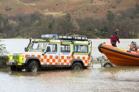 Floods;flooding;flooded;Glenridding;Ullswater;Cumbria;Lake-District;UK;weather;extreme-weather;climate-change;global-warming;deluge;torrential-rain;downpour;meteorology;low-pressure;weather-front;rain;raining;heavy-rain;precipitation;wet;sodden;flood-waters;tarmac;flood-damage;ripped-up;debris;flood-debris;village;fridge;storm-Desmond;clearup;cleanup;road;destroyed;destruction;tarmac;lifted;ripped-up;Land-Rover;emergency-services;mountain-rescue-mountain-rescue-team;Patterdale-Mountain-Rescue-Team;relief;volunteer;volunteers;relief-work;boat;rib;inflateable;trailer;launch;launching